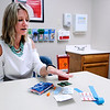 Don Knight | The Herald Bulletin<br /> Stephanie Grimes talks about the items distributed as part of the needle exchange program in Madison County.