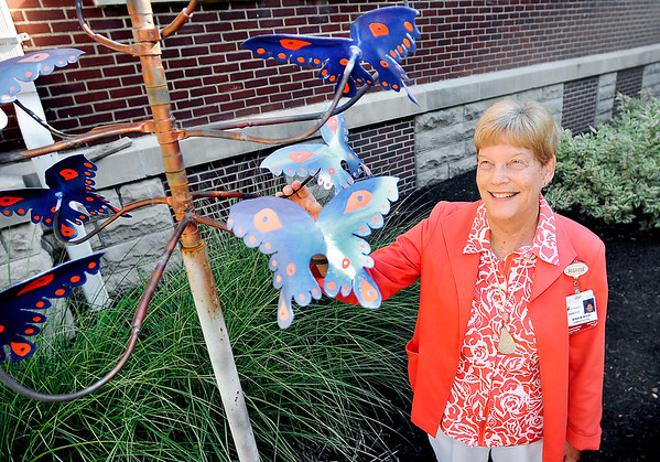 John P. Cleary |  The Herald Bulletin Nancy Pitcock, vice president and chief nursing officer for St. Vincent Anderson, is retiring after 46 years of service at the hospital. Here she looks over the butterfly tree that is in the Healing Garden of the hospital. The tree is in memory of Nancy's mother Romona Sylvester.