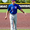 Chris Martin for The Herald Bulletin <br /> Daleville Assistant Coach Wally Winans coaching 1st base at the North vs South Indiana High School All Star game Saturday at Ball State.