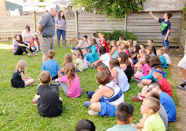 "Don Knight | The Herald Bulletin<br /> Pastor Rodney Ellis teaches the story of the Prodigal Son during vacation Bible school ""Down on the Farm"" at First Missionary Baptist Church in Elwood on Tuesday."