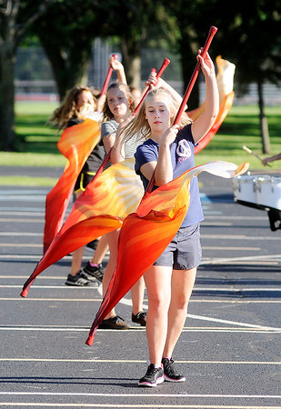 Don Knight   The Herald Bulletin<br /> Color guard member Deva Finch rehearses with the Elwood band as they prepare for State Fair Band Day.