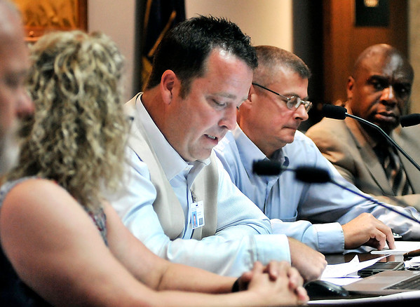 John P. Cleary |  The Herald Bulletin<br /> After several motions Councilman Brent Holland reads the ordinance for the record to eliminate funding or donations for the county's needle exchange program Tuesday evening.