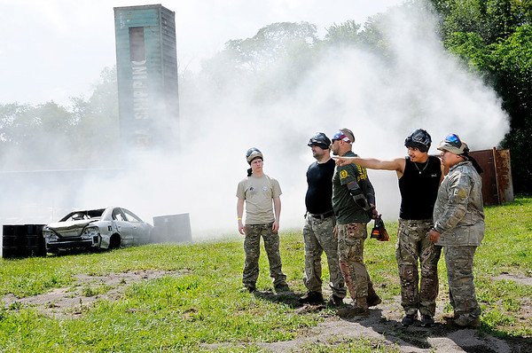 Don Knight | The Herald Bulletin<br /> Paintball enthusiasts get their first look at White River Paintball's new field Cargo City as smoke from grenades tossed during the ribbon cutting still lingers in the background on Saturday.