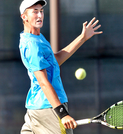 John P. Cleary    The Herald Bulletin<br /> Joseph Conrad follows his shot during play in the Men's A singles finals match against Garret Fensler Saturday evening at the Community Hospital Anderson Tennis Classic.