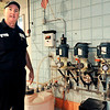 John P. Cleary |  The Herald Bulletin<br /> Alexandria water Superintendent Mark Caldwell shows the fluoride system, which he turned off in 2008, with it's three pumps for each of the city's wells.