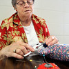 John P. Cleary |  The Herald Bulletin<br /> Janette Batts sews on the detail pieces to the Love Bear she is working on.
