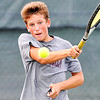 John P. Cleary |  The Herald Bulletin<br /> Trevor Simison returns a shot during his boys varsity singles match against Seth Moore Monday evening during Community Hospital Anderson Tennis Classic action.