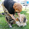 Don Knight | The Herald Bulletin<br /> Ann Stevenson blesses Chewy Hacker, a Pomeranian, during the People & Pets Extravaganza at New Horizon United Methodist Church on Saturday.