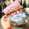 Don Knight | The Herald Bulletin<br /> Sam Hockwalt holds a collection of post cards he collected on a trip to Europe this summer.