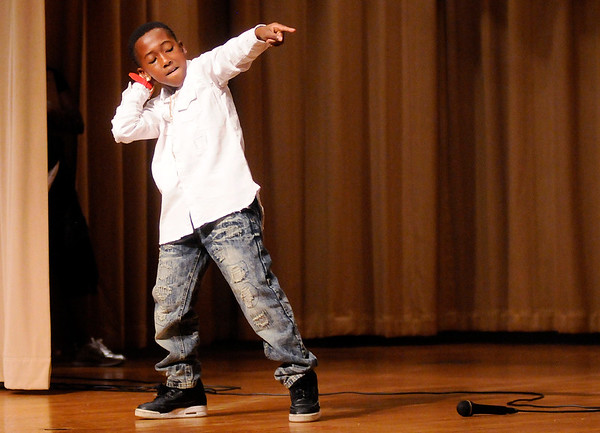 "Don Knight | The Herald Bulletin<br /> Michael Rendle, 9, dances to the Bruno Mars song ""That's What I Like"" during the Anderson Black Expo Youth Talent Showcase at the City Building on Thursday."