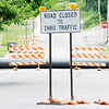 Don Knight | The Herald Bulletin<br /> Henry Street is closed between 9th and 10th Streets as four sewer bypass pipes cross the street on Thursday. The bypass pipes are part of the $4 million rehabilitation of the Greensbranch sewer.