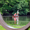 John P. Cleary |  The Herald Bulletin<br /> These anglers are framed inside the curves of the Changing Forms steel sculpture as they fish the lake at Shadyside Park Monday.