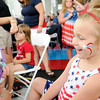 "Don Knight | The Herald Bulletin<br /> Alexia Ely, 4, smiles after seeing her star face painting during ""Fire it Up on the Fourth"" at Hoosier Park on Tuesday."