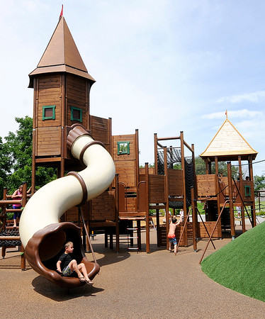 Don Knight   The Herald Bulletin<br /> Kids play on the new playground equipment at Daleville's new Town Hall Park on Wednesday.