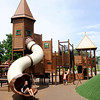 Don Knight | The Herald Bulletin<br /> Kids play on the new playground equipment at Daleville's new Town Hall Park on Wednesday.