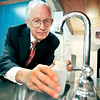 John P. Cleary |  The Herald Bulletin<br /> Alexandria dentist and City Council member Dr. David Steele takes a water sample to have it tested for it's level of fluoride.
