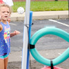 Don Knight | The Herald Bulletin<br /> Abygail VanBuskirk, 6, tosses a ball through a hoop while playing a game during Harrison College's Back to School Carnival on Friday. The event included games, face painting, an inflatable and giveaways.