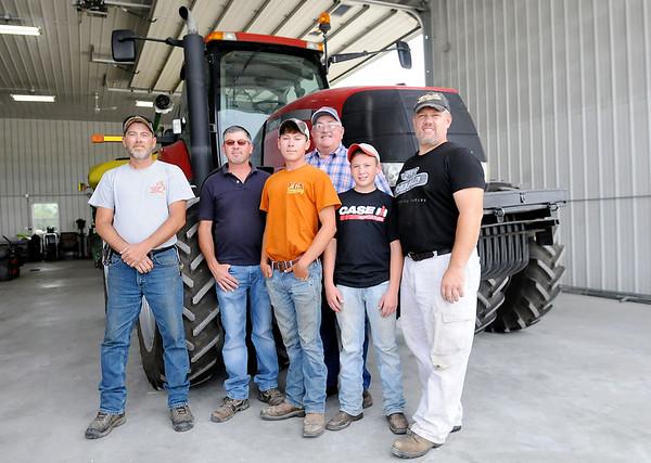 Don Knight | The Herald Bulletin<br /> From left, Shane Benefyel, Andy Bracken, Brock Bracken, Vaughn Bracken, Drew Bracken and Carl Bracken at Bracken Farms on Thursday.