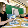 John P. Cleary |  The Herald Bulletin<br /> First-year teacher Shelly Bruzzese cuts out material as she works Friday preparing her kindergarten classroom at Alexandria-Monroe Elementary School for the first day of school Monday.