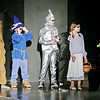 "Mark Maynard | for The Herald Bulletin<br /> To understand the Emerald City, the Cowardly Lion (Audrey Salazar), the Scarecrow (Elijah Bock), the Tinman (Tyler McCorkle), Toto (Mason Hill) and Dorothy (Hannah Whipple) don green glasses provided by a Guardian in the youth production of ""Oz"" at the Alexandria Commons Theatre."