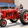 Don Knight | The Herald Bulletin<br /> A classic tractor is driven down Main Street as Summitville held a parade as part of their 2nd annual Firecraker Festival on Saturday.
