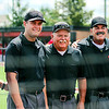 Chris Martin for The Herald Bulletin <br /> Daleville Head Coach Terry Turner and Daleville Assistant Coach Wally Winans pose with the umpires before the North vs South Indiana High School All Star game Saturday at Ball State.