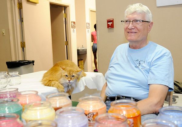 Don Knight   The Herald Bulletin<br /> Ed Birt and his cat Skamper sell scented candles during the People & Pets Extravaganza at New Horizon United Methodist Church on Saturday.