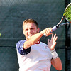John P. Cleary |  The Herald Bulletin<br /> Garrett Fensler returns forehand shot during his Men's A singles finals match against Joseph Conrad Saturday at the Community Hospital Anderson Tennis Classic.