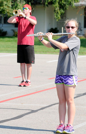 Don Knight | The Herald Bulletin<br /> From right, Hope Robleto and Elijah Hahn rehearse with the Frankton Marching Eagles on Wednesday.