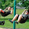 John P. Cleary | The Herald Bulletin<br /> Trevor Grimm, 8, looks over toward his brother, Memphis, 11,  to see if he's swinging higher as they play together at the Pulaski Park playground Friday.<br /> The Grimms are from the Sulphur Springs area and were in Anderson visiting relatives.