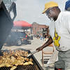John P. Cleary | The Herald Bulletin<br /> Lapel Lions Club member Rick Coleman mans the grill as he cooks up chicken wings at their booth at the annual Lapel Village Fair.