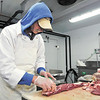 John P. Cleary | The Herald Bulletin<br /> Bill Sexton prepares meat for packaging at The Smith Family Farm Market in Pendleton.