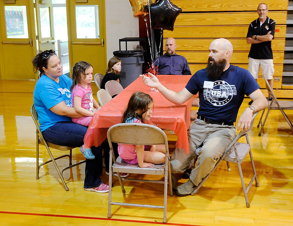 Don Knight | The Herald Bulletin<br /> Justin Busick introduces his wife Veronica and daughters Grace and Eliza<br /> Liberty Christian new family picnic.
