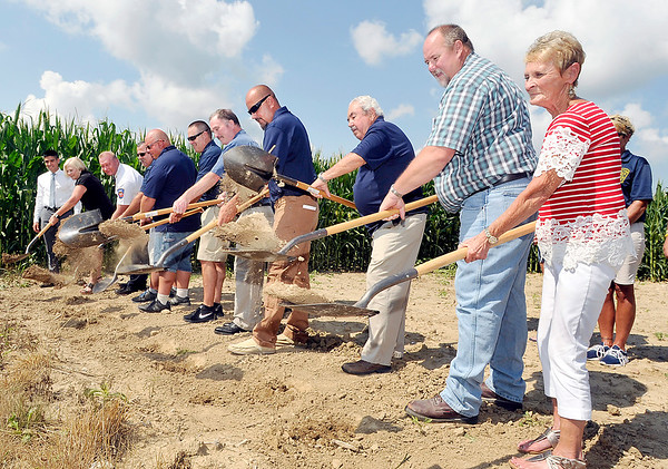 John P. Cleary | The Herald Bulletin<br /> Lafayette Township board members, fire department personnel, and area dignitaries toss dirt as they break ground Tuesday for the Lafayette Township Volunteer Fire Department expansion project. The expansion will add three bays for more emergency vehicles.