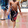 Don Knight | The Herald Bulletin<br /> Keybren McCullough runs through streams of water while keeping cool at the Daleville splash pad on Saturday.