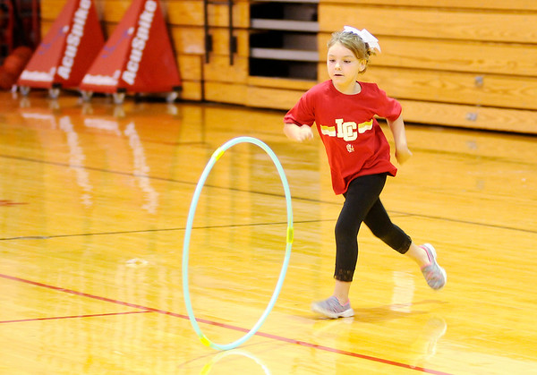 Don Knight | The Herald Bulletin<br /> Haddon Schroer, 6, plays with a hoop during Liberty Christian's new family picnic hosted by the Parent Teacher Fellowship.