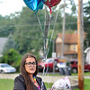 John P. Cleary | The Herald Bulletin<br /> Jamie Johnson, of the Family Rights Protection Foundation, organized a vigil to honor the memory of Harlan Haines, Paisley Hudson, and Caridie Wisler Monday evening at Athletic Park. They released balloons and lanterns in the childrens memory.