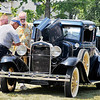 John P. Cleary | The Herald Bulletin<br /> The annual Lapel Village Fair drew a large number of vehicles for their car show held at the Daybreak Community Church. Here these men check out this old Ford during the show.