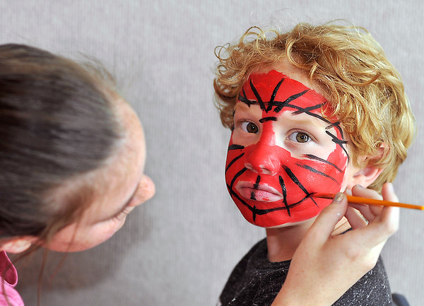 John P. Cleary   The Herald Bulletin<br /> Kameron Standler, 5, gets his spiderman face painted by Kylie Patton, 14, of the Alexandria-Monroe HS cheerleaders, Monday during the Alexandria city-wide Back to School Rally. Kameron will be starting kindergarten this year.