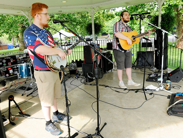 Don Knight | The Herald Bulletin<br /> The Booze Hounds perform in the gazebo at Falls Park during Pendleton's 4th at the Falls celebration on Wednesday.