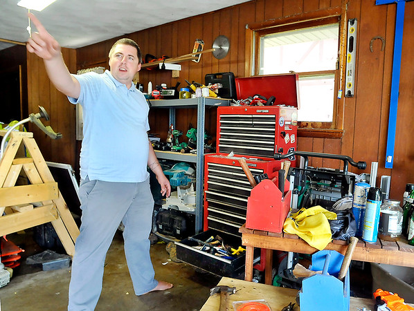 John P. Cleary | The Herald Bulletin<br /> Chris Johnson has seen crime increase in his normally quiet neighborhood on the east side of Anderson. Here Johnson shows the direction in which a suspect ran after he was caught in his garage going through a tool chest.