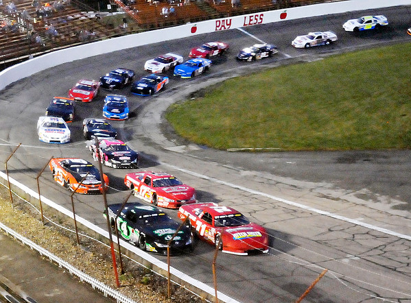 John P. Cleary | The Herald Bulletin<br /> Johnny VanDoorn gets the jump at the green flag over Dalton Armstrong at the start of the Redbud 400 Monday night.