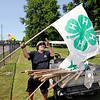 Don Knight | The Herald Bulletin<br /> Jon Hoschouer puts out 4-H flags at Beulah Park in Alexandria on Friday. Kiwanis members were starting the process of preparing the park for the fair.