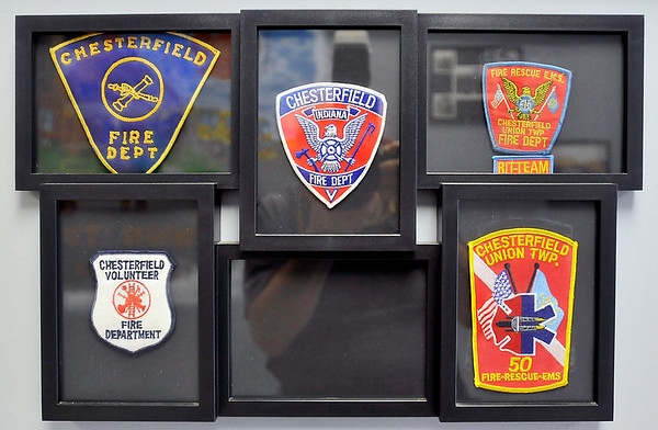 John P. Cleary   The Herald Bulletin<br /> Some of the different uniform patches for the Chesterfield-Union Township Fire Department over the years.