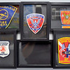 John P. Cleary | The Herald Bulletin<br /> Some of the different uniform patches for the Chesterfield-Union Township Fire Department over the years.