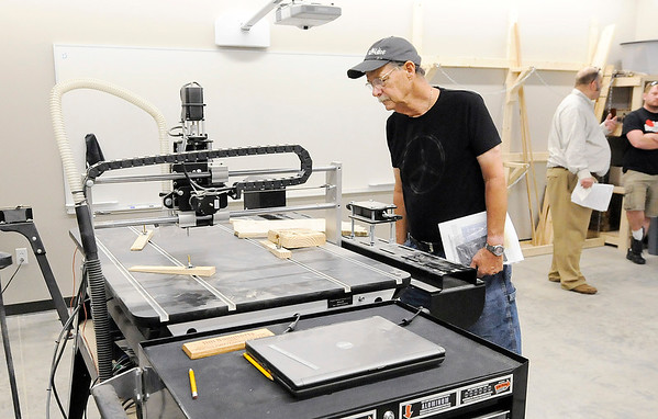 Don Knight | The Herald Bulletin<br /> Phil McDonald looks at a CNC wood router during an open house at Purdue Polytechnic Makerspace on Friday.