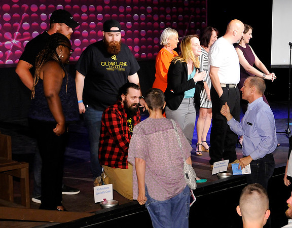 Don Knight | The Herald Bulletin<br /> Audience members cast their vote and meet the people behind six pitches during Pitch Night at Mainstage Theatre on Wednesday.