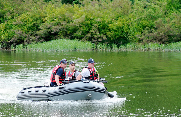 Don Knight | The Herald Bulletin<br /> Richland Township's water rescue boat returns to shore after the woman they were searching for was found safe at a nearby home at Prosperity Lake on Tuesday.