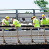 Don Knight | The Herald Bulletin<br /> Workers install a railing on the new Eisenhower Bridge over the White River on Thursday. The new bridge will be six feet lower than the current span and include pedestrian and bicycle lanes and overlooks for people to observe the river.