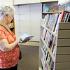 Don Knight | The Herald Bulletin<br /> Sue Gwaltney shops for books at the Book Nook at their new location in the Southdale Plaza on Wednesday.